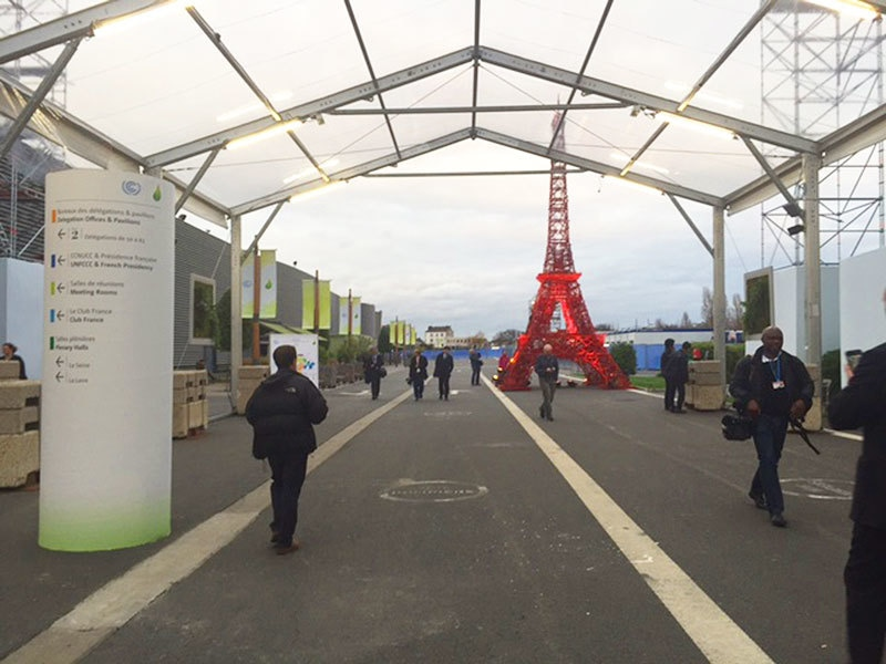 A mini model of the Eiffel Tower stands inside Le Bourget conference centre.
