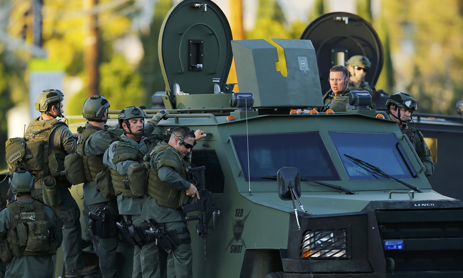 Police officers conduct a manhunt after the mass shooting in San Bernardino. ─ Reuters