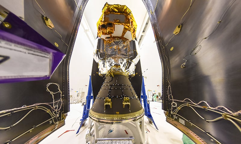 European Space Agency ESA shows the LISA Pathfinder being encapsulated within the half-shells of the Vega rocket fairing on at the Centre Spatial Guyanais in Kourou, French Guiana. — AP