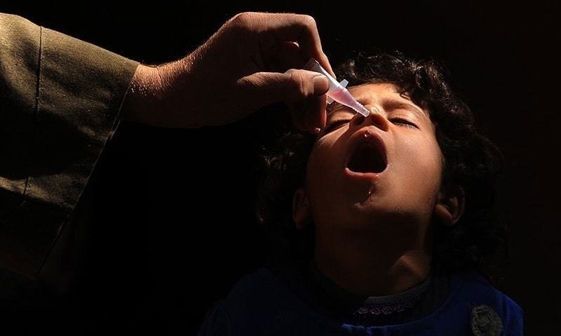 A child is being administrated polio vaccine.—AFP/File