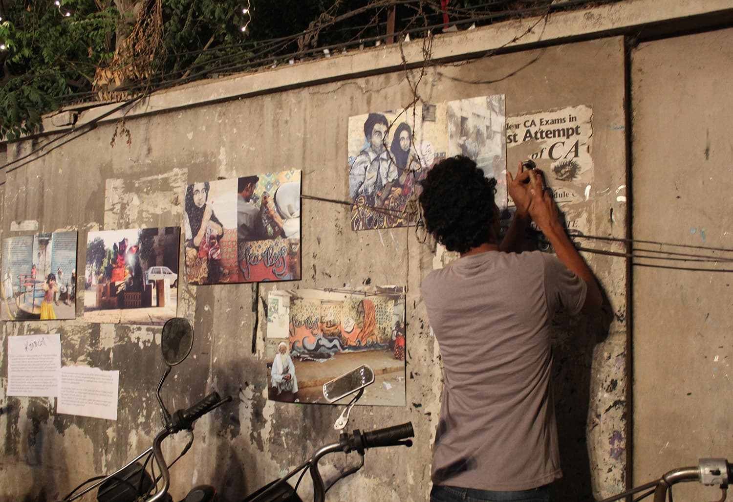 A man hammers the pictures on the wall. — Photo by Zeresh John