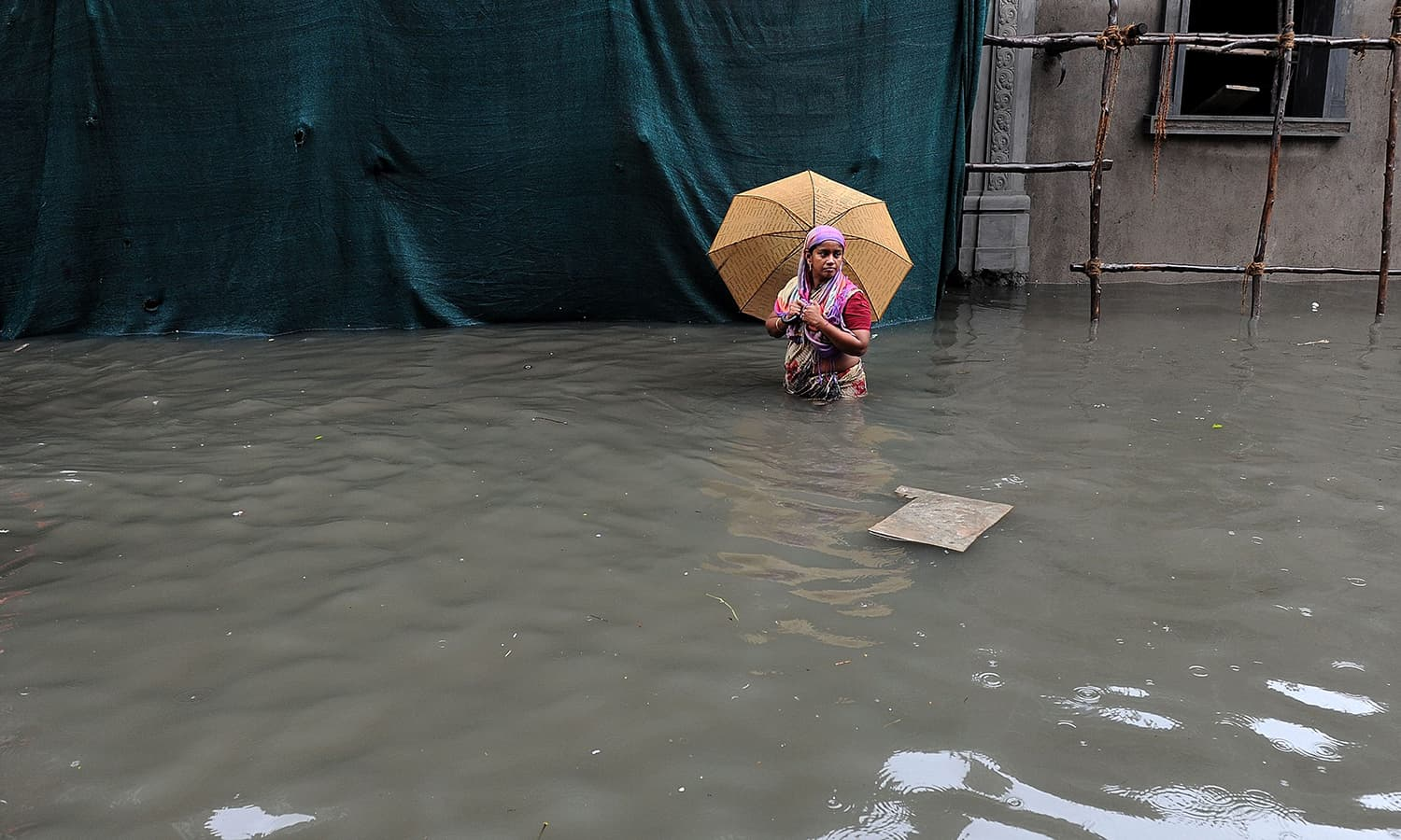 An Indian woman wades through floodwaters in Chennai on December 2, 2015. — AFP