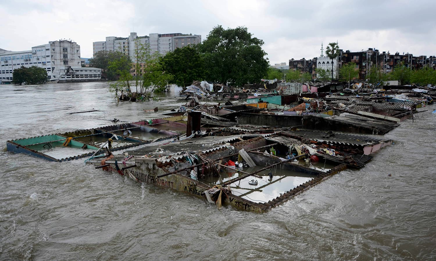 This general view shows buildings inundated by floodwaters in Chennai on December 3, 2015. — AFP