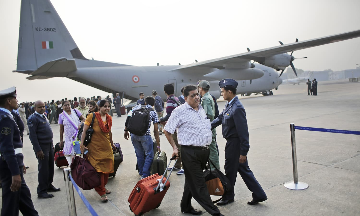 People who were stranded in Chennai due to floods arrive in New Delhi after being evacuated by Indian Air Force, in New Delhi, India, Thursday, Dec. 3, 2015. — AP