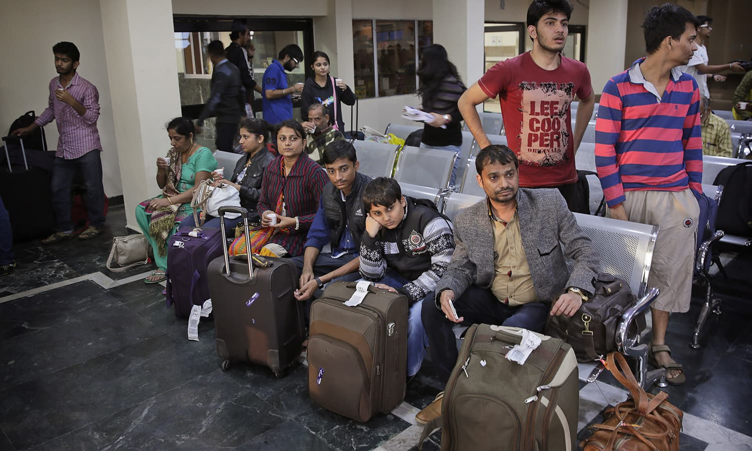 Indians wait for their onward journey at the Palam Airport after being evacuated from flood affected southern Indian city of Chennai by special Indian Air Force plane in New Delhi, India, Thursday, Dec. 3, 2015. — AP