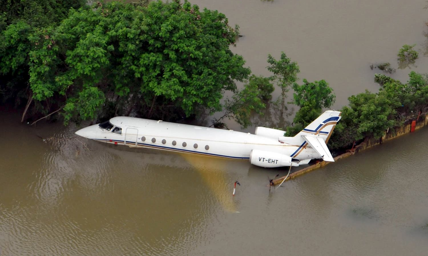 An aerial view of a partially submerged airplane is pictured in a flood affected area in Chennai, India, December 3, 2015. — Reuters