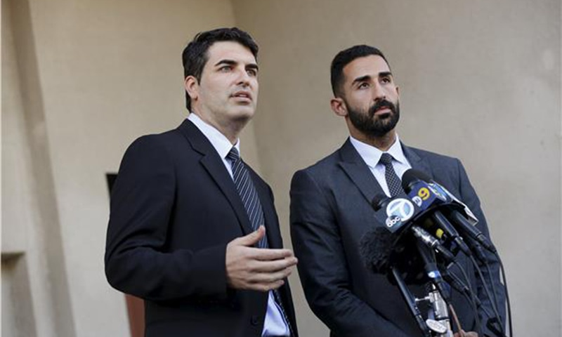 Lawyers representing the Farook family, David S. Chesley and Mohammad Abuershaid (R), speak during a news conference in Los Angeles, California.—Reuters/File