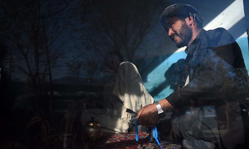 Hazara Afghans drink tea inside a local restaurant in the Dasht-E-Barchi Hazara neighbourhood of Kabul. — AFP