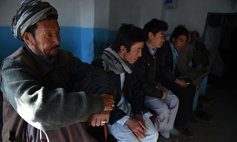 Hazara Afghans look on as they sit inside a local restaurant in the Dasht-E-Barchi Hazara neighbourhood of Kabul. — AFP