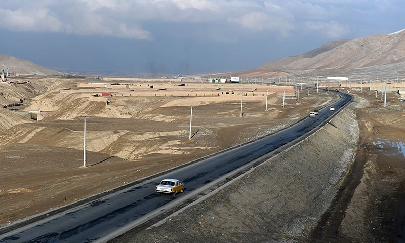 Afghan local vehicles with passengers travel on the highway to Maidan Wardak province west of Kabul. — AFP