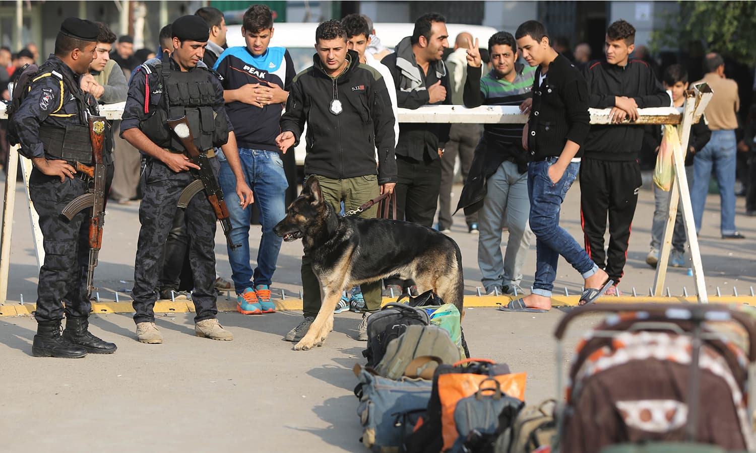 Iraqi security forces use a sniffer dog to inspect the luggage of Shias pilgrims at Baghdad central train station. Iraqi officials say security was stepped up this year for the millions of pilgrims who descended on the holy city of Karbala to mark the commemoration of Arbaeen Wednesday. Operations were coordinated between the interior ministry, an umbrella group of militia volunteers and Iranian advisers. —AFP