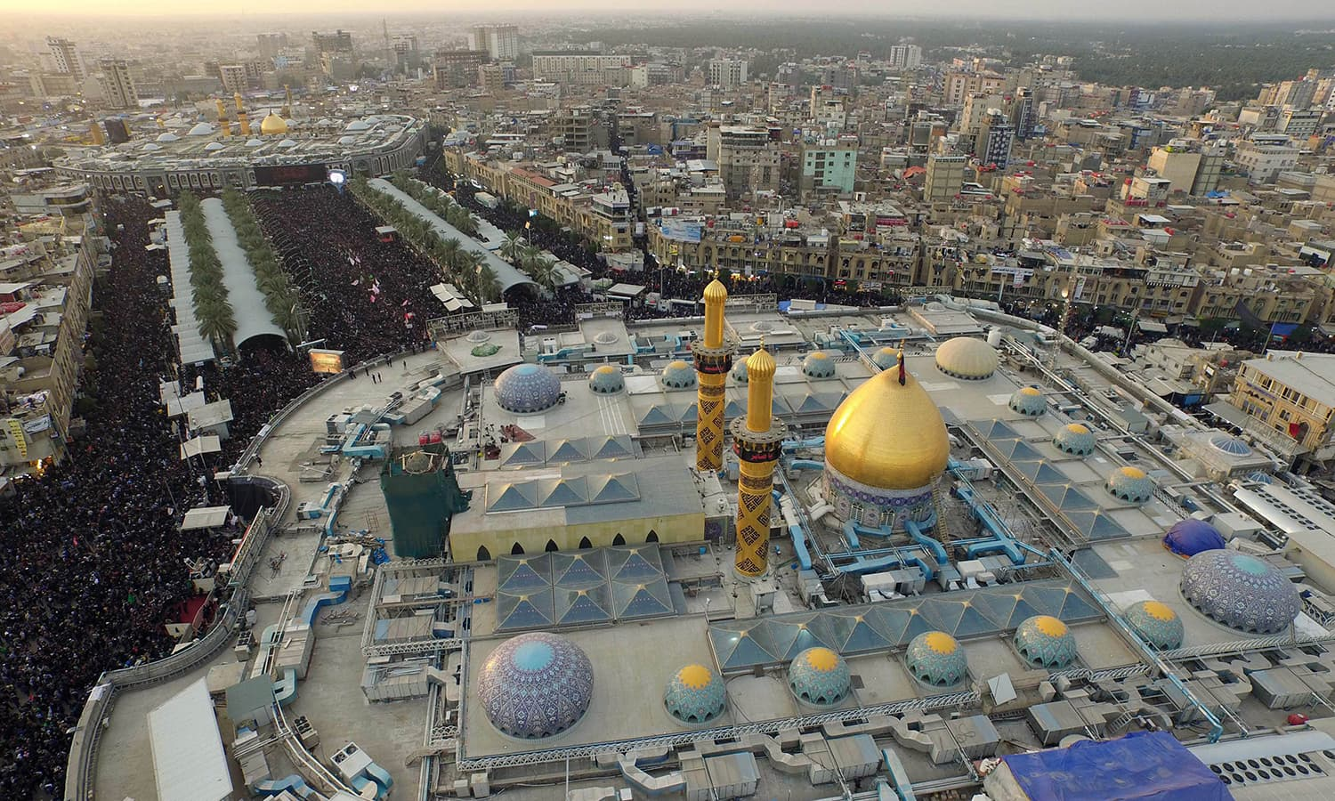An aerial view taken on shows Iraqi Shia pilgrims gathering at the shrines of Imam Abbas ibn Ali (front) and Imam Husain (background). —AFP