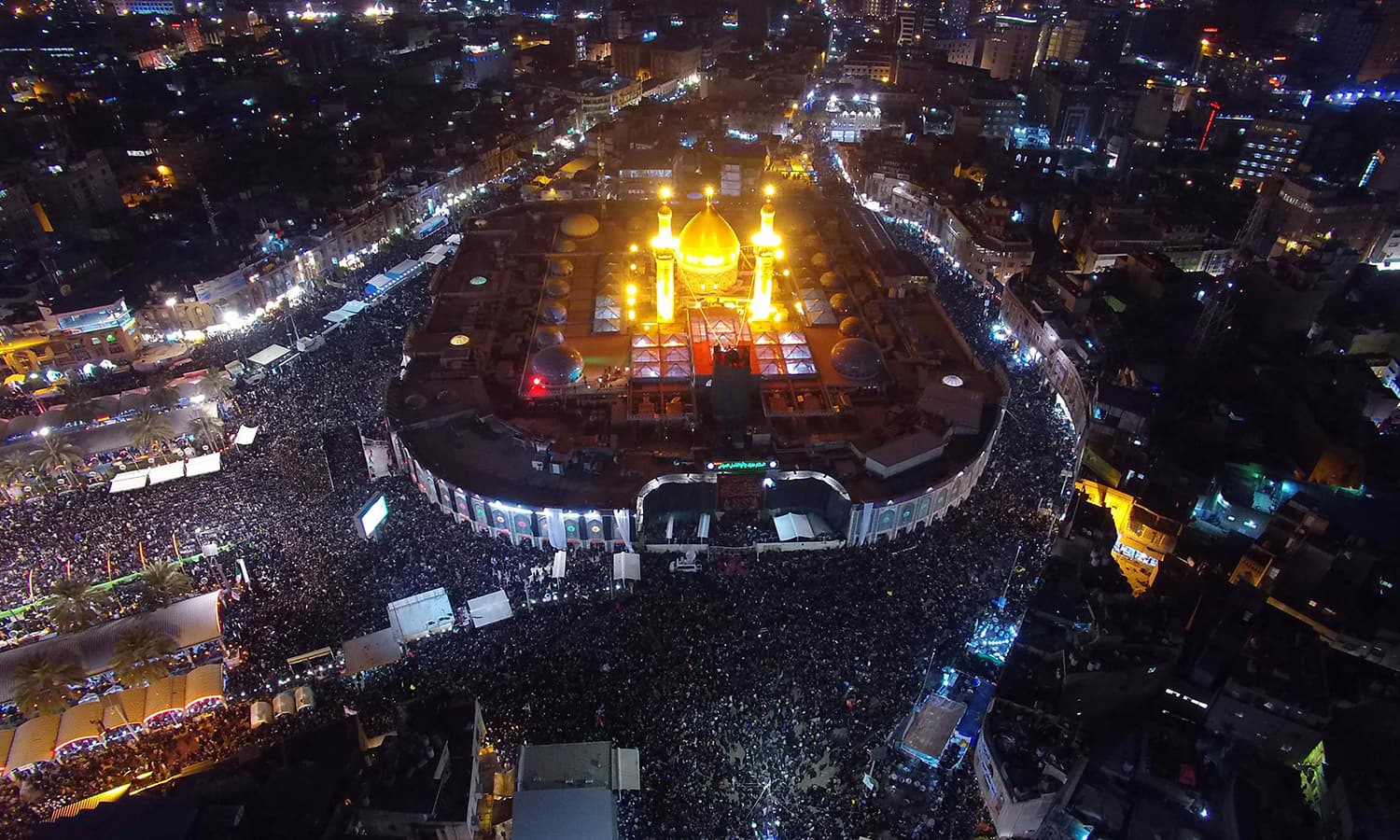 An aerial view taken shows Iraqi Shia pilgrims gathering at the shrine of Imam Abbas ibn Ali, the brother of Imam Husain. —AFP
