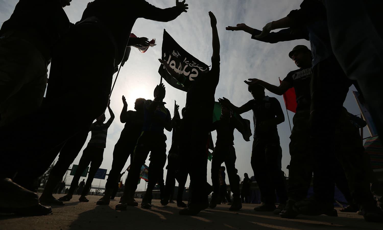 Iraqi Shia pilgrims participate in the Arbaeen ritual in Baghdad, Iraq,  —AP