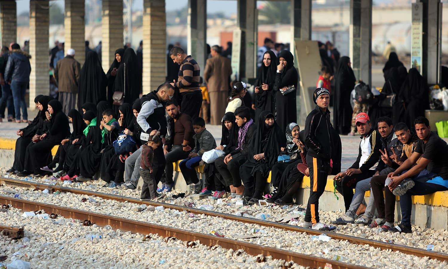 Shias pilgrims wait to board a train at Baghdad central station. Thousands of Shia faithful heading to and returning from the holy city of Karbala have been massing in central Baghdad station in the days running up to the culmination of Arbaeen. —AFP