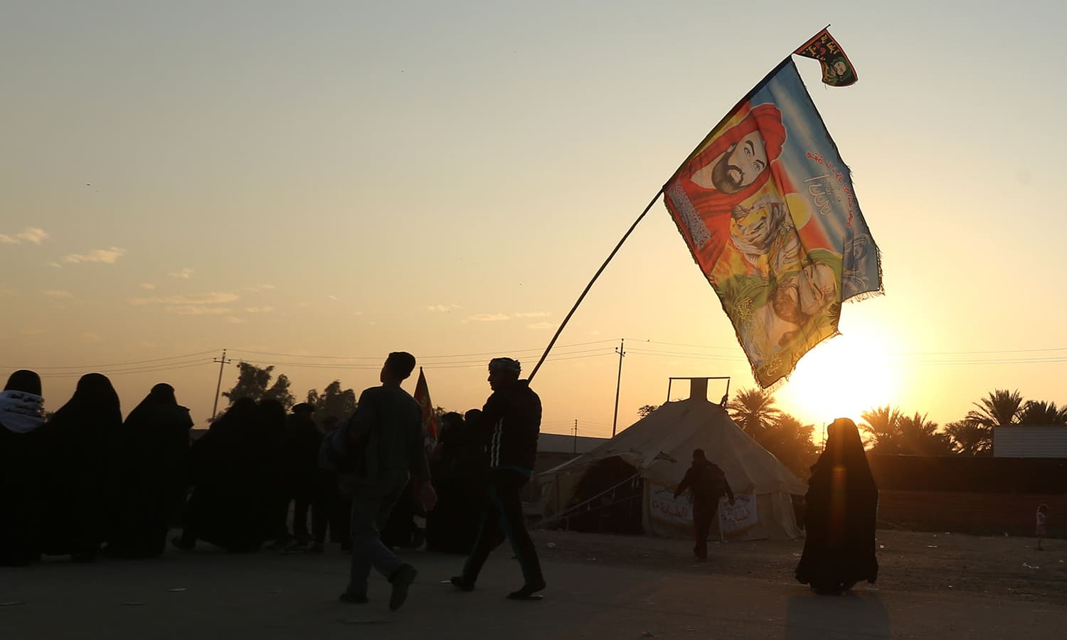 Shia pilgrims march to Karbala during the Arbaeen ritual in Baghdad, Iraq on Sunday. The Shia ritual of Arbaeen marks the end of a 40-day mourning period for the killing of Prophet Muhammad (PBUH)'s grandson Imam Husain 13 centuries ago. —AP