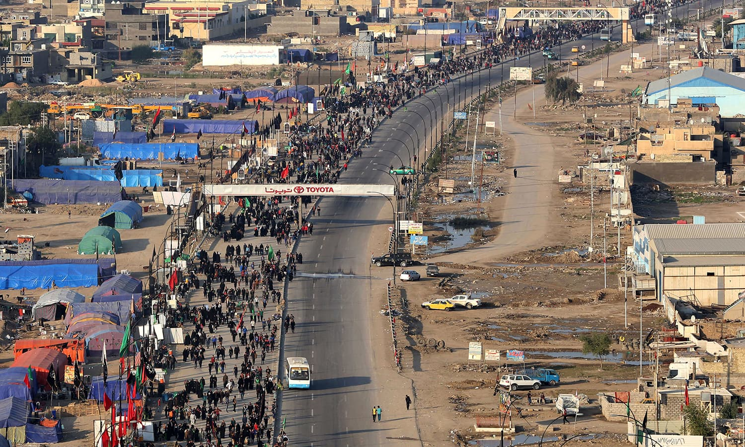 Shia pilgrims march to Karbala during the Arbaeen ritual in Baghdad, Iraq. The total number of pilgrims who have visited Karbala is more than 22 million.  —AP