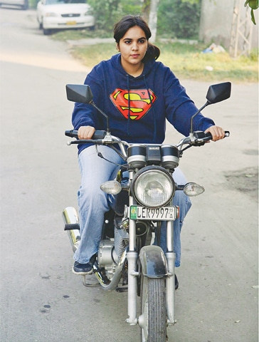 TWENTY-year-old Zenith has been riding a motorbike Suzuki GS 150 for the past three years.—Azhar Jafri / White Star