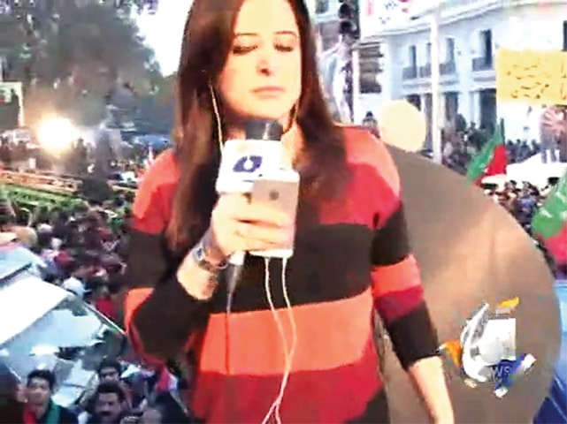 Standing between a sea of men, Geo News' Sana Mirza reports on PTI's Azadi sit-in, where she was later harassed by party workers. Similar cases of harassment were reported by Gharida Farooqi of Samaa and Abb Takk's Quatrina Hosain