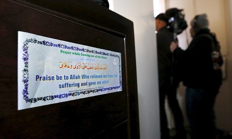 A religious sticker is shown inside the home of the suspects. ─ Reuters