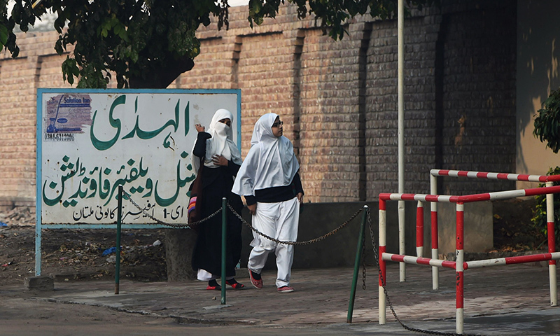 Students arrive at Al-Huda Institute, one of the most high-profile religious teaching centre for females, in Multan on December 7, 2015, where female US shooter Tashfeen Malik studied. — AFP