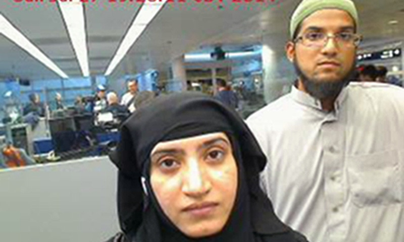 Photo provided by US Customs and Border Protection shows Tashfeen Malik, (L), and Syed Farook, as they passed through O'Hare International Airport in Chicago. — AP