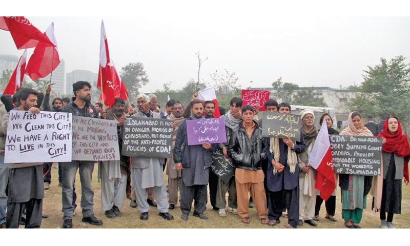 Slum dwellers protest outside the National Press Club on Tuesday. —INP