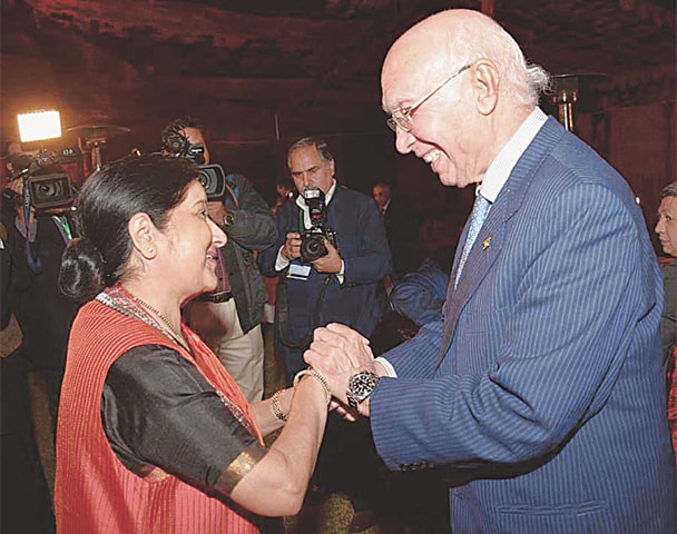 ISLAMABAD: Adviser to PM on Foreign Affairs Sartaj Aziz and Indian External Affairs Minister Sushma Swaraj shake hands at the Pakistan National Council of the Arts here on Tuesday.—APP