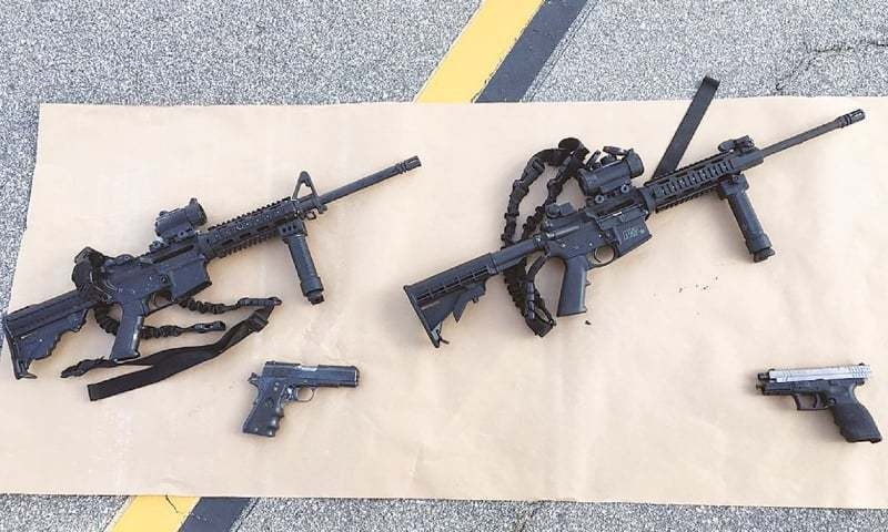 The AR-15's and the handguns used in the shootings.— AFP/File