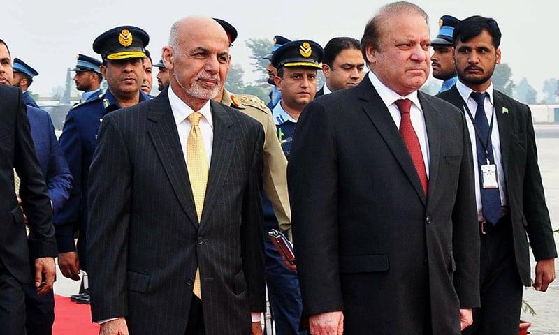Prime Minister Nawaz Sharif receives Afghan President Ashraf Ghani upon his arrival at Nur Khan airbase. ─ AP