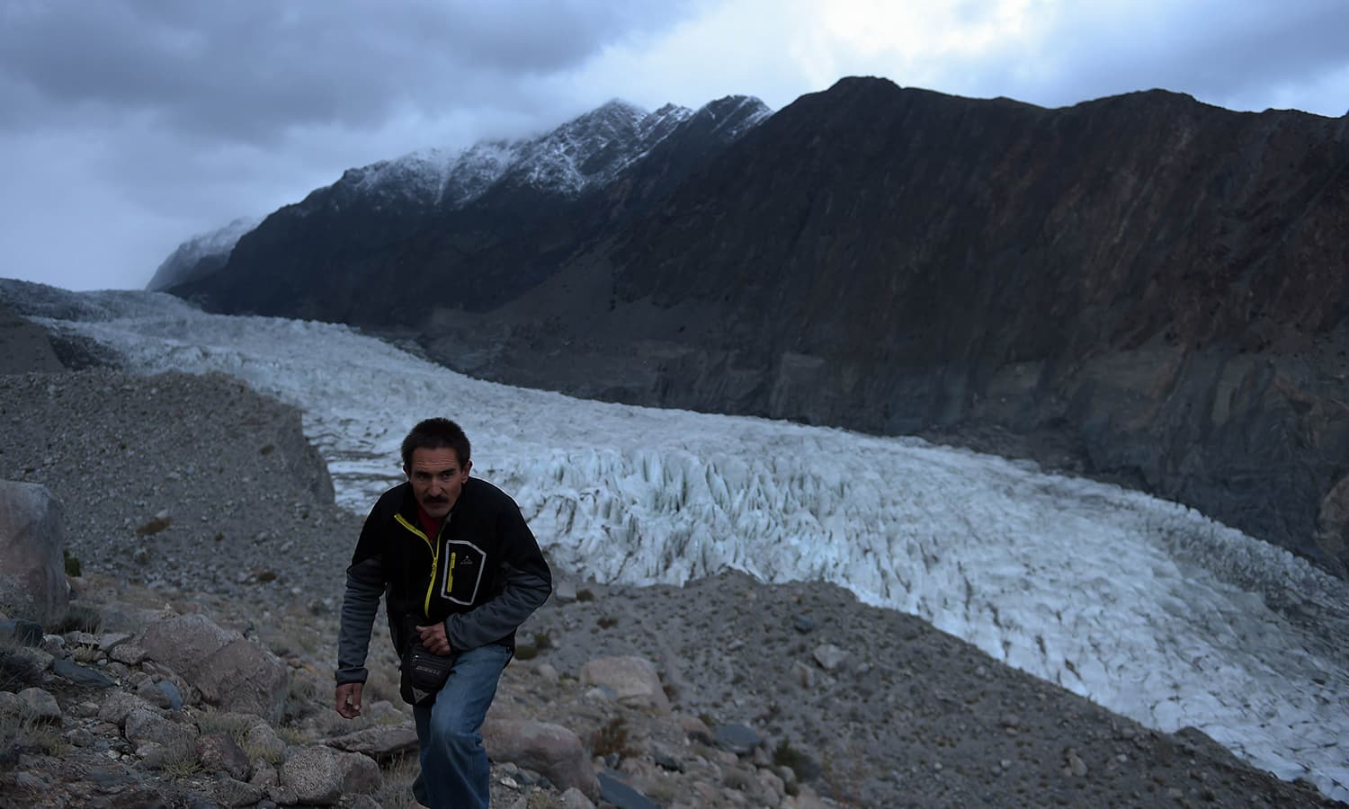 A Pakistan Meteorological Department (PMD) employee takes observations at a glacier monitoring station, set at an elevation of 4,500 meters, at the 26km-long Passu glacier in the Gojal Valley. — AFP