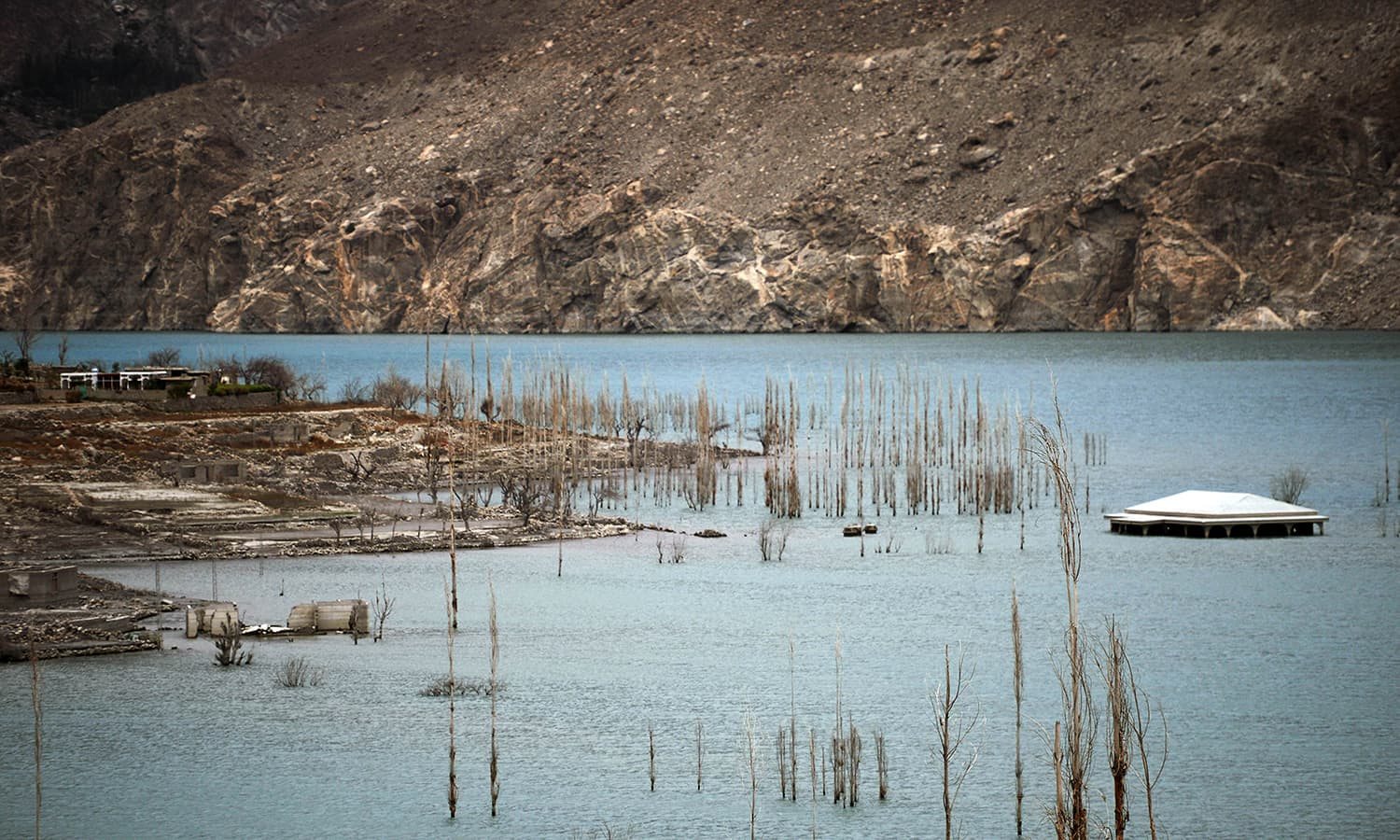 A partially-submerged house is seen in Attabad Lake, which was formed following a landslide in January 2010, in Pakistan's Gojal Valley. — AFP