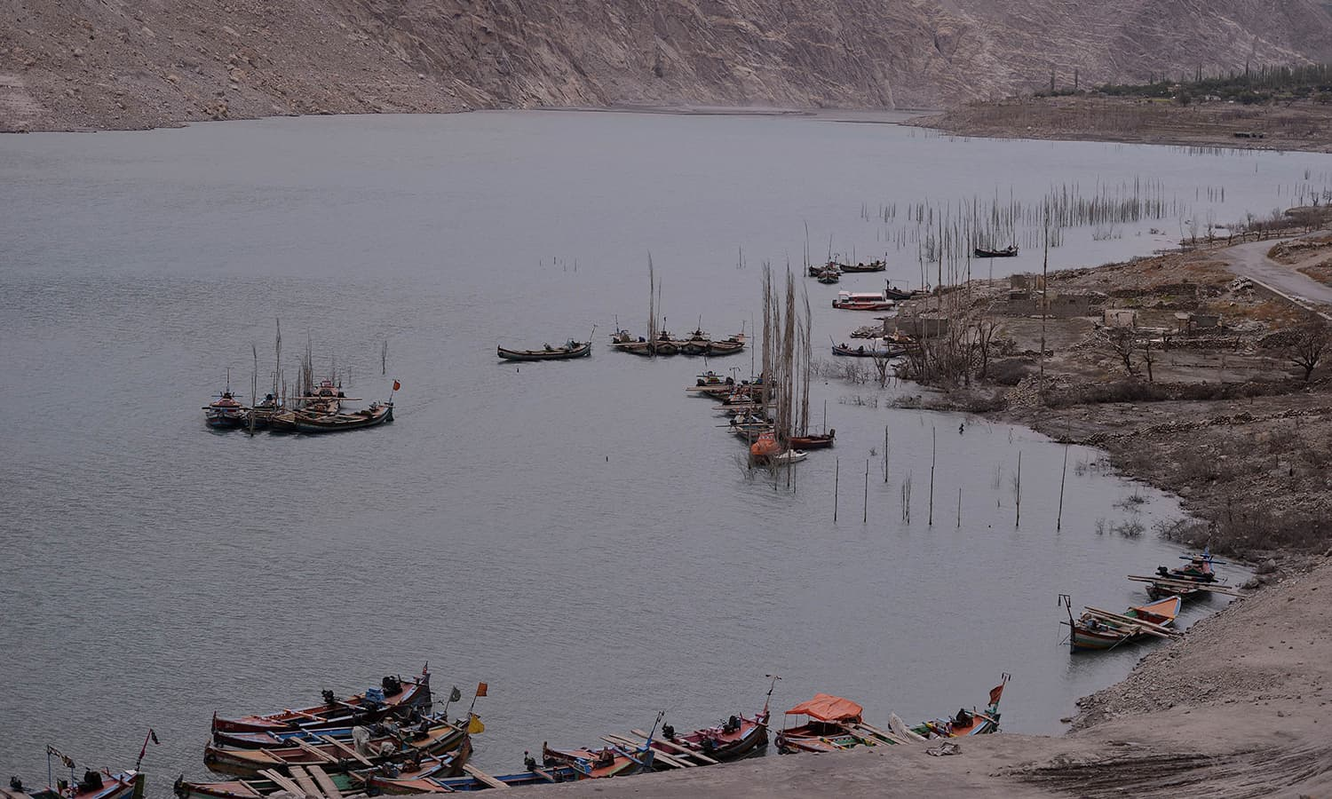 Boats are moored in Attabad Lake, which was formed following a landslide in January 2010, in Pakistan's Gojal Valley. — AFP