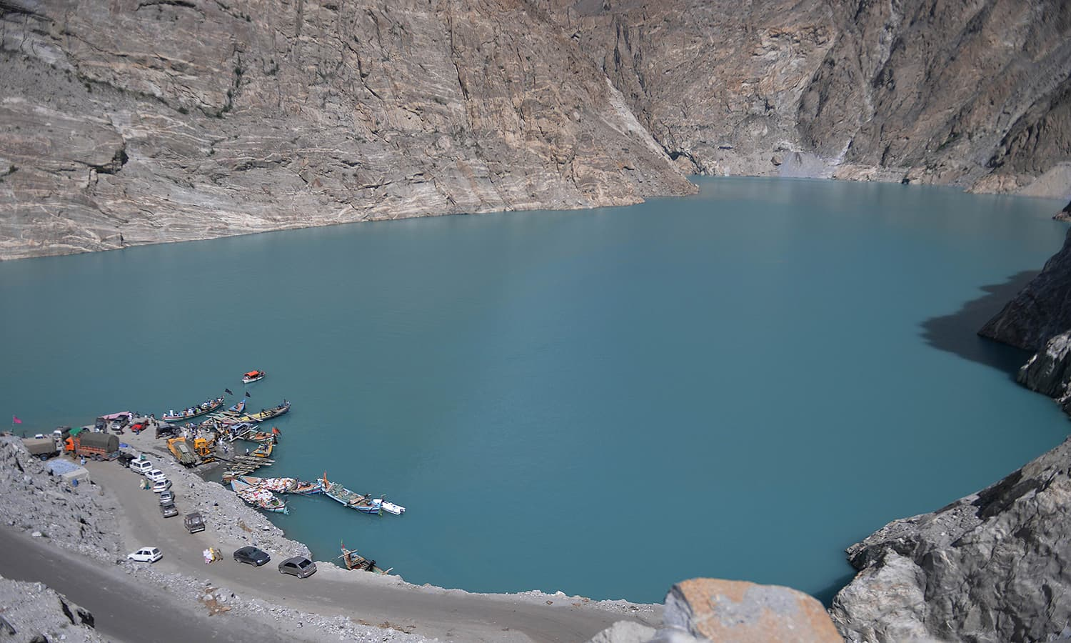 Pakistani residents board boats used to cross Attabad Lake, which was formed following a landslide in January 2010, in Pakistan's Gojal Valley. — AFP