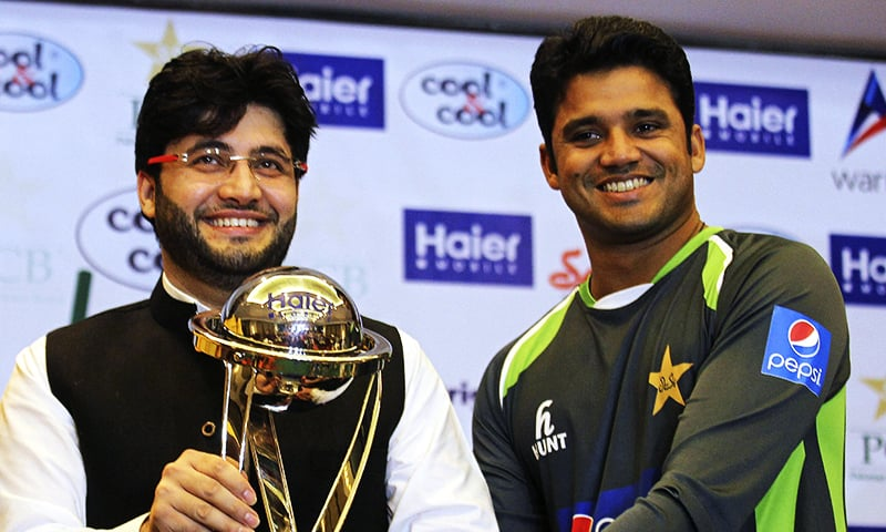 Javed Afridi, CEO of Haier Home Appliances, and Pakistan's one-day captain Azhar Ali unveil the trophy for Zimbabwe ODIs at the Gaddafi Stadium in Lahore on Monday, May 25, 2015. — AP/File