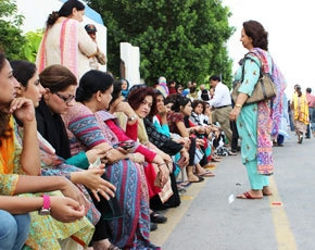 The 'affluent' wait to cast their vote in a Karachi constituency in 2013.