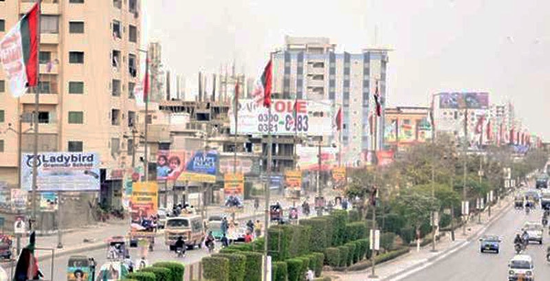 MQM flags flutter in a Mohajir-majority area in Karachi.