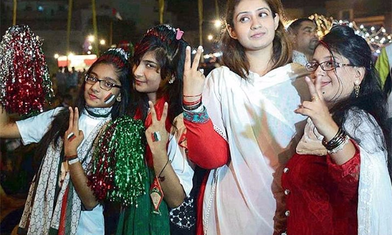 MQM supporters celebrating their party's victory.