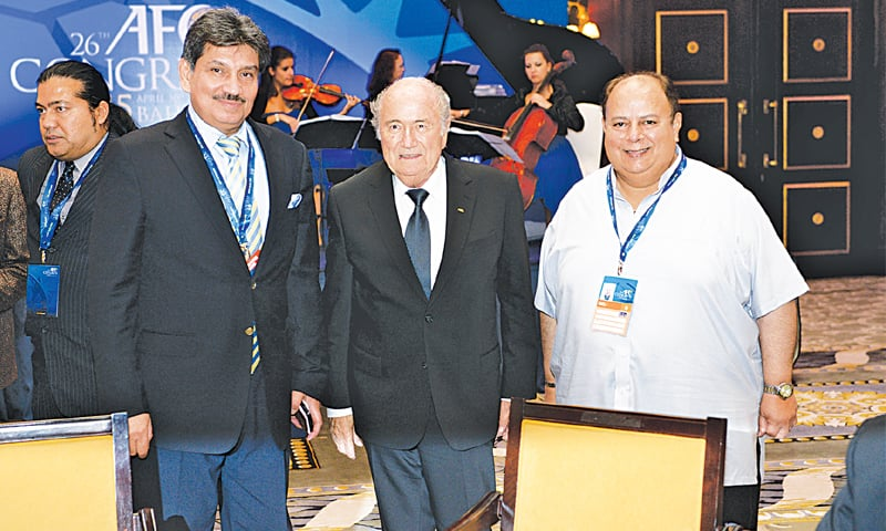 Sardar Naveed Haider (R) poses with Sepp Blatter during May's AFC Congress in Manama. — Courtesy PFF