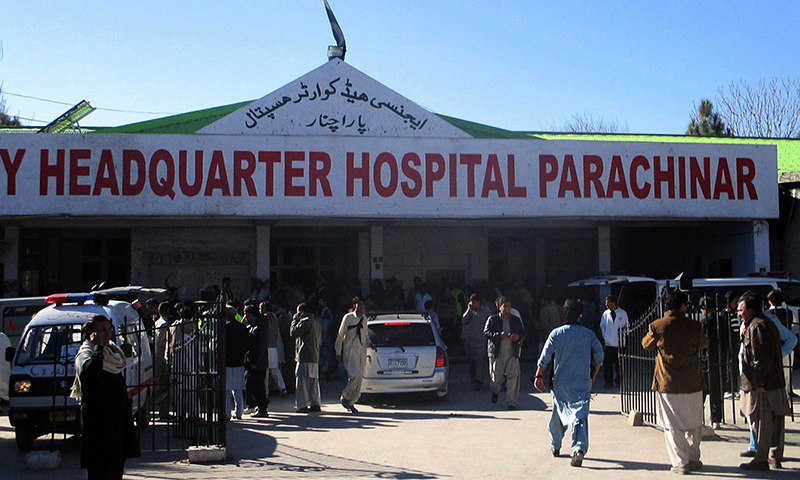 Paramedics and residents gather outside a hospital after a bomb explosion at a market in Parachinar. — AFP