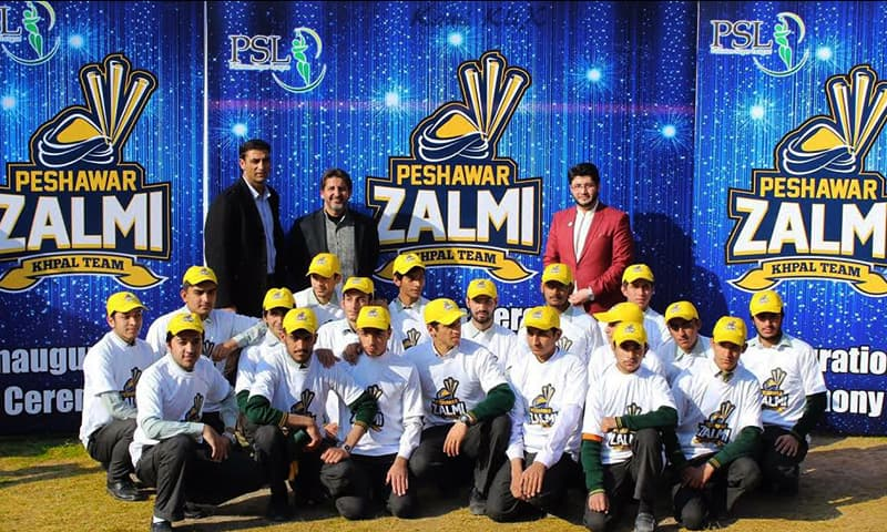 APS students in a group photo during Peshawar Zalmi's launch event.