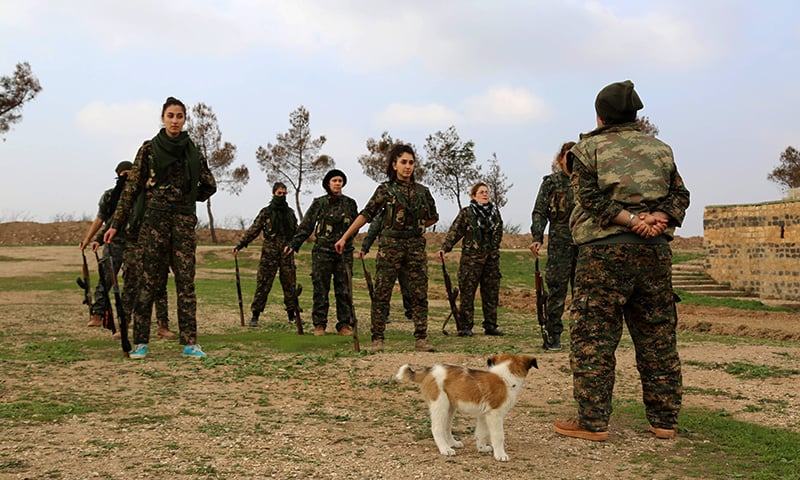 """Syriac Christian women, members of the battalion called the """"Female Protection Forces of the Land Between the Two Rivers"""" fighting the Islamic State group, take part in training. — AFP"""