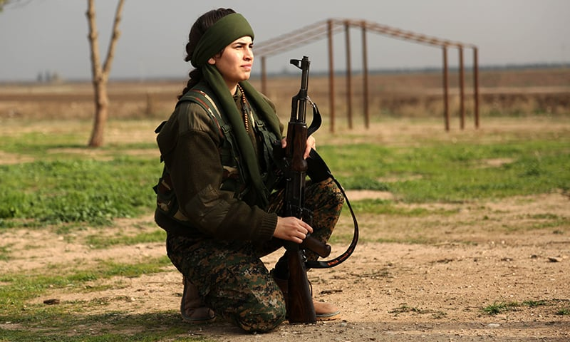 """Syriac Christian Lucia, members of the battalion called the """"Female Protection Forces of the Land Between the Two Rivers"""" fighting the Islamic State group, take part in training. — AFP"""