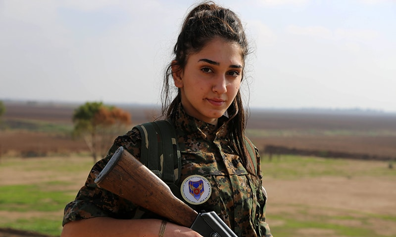 """Syriac Christian Ormia, member of the battalion called the """"Female Protection Forces of the Land Between the Two Rivers"""" fighting the Islamic State group, poses during a training. — AFP"""