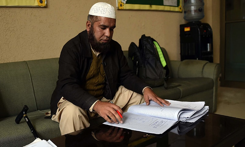 Abu Bakar, 43, a teacher, who survived the APS massacre of December 16, 2014, the deadliest terror attack in Pakistan's history, works at the army-run school in Peshawar. — AFP