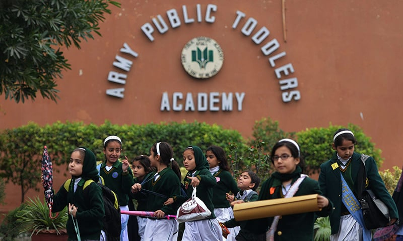 Students leave APS, the scene of the Dec 16 massacre ─the deadliest terror attack in Pakistan's history. — AFP