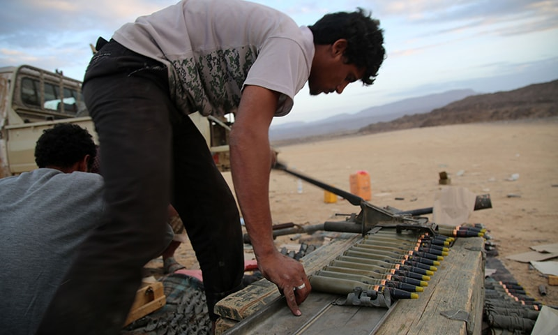 Yemeni tribesmen from the Popular Resistance Committees, supporting forces loyal to Yemen's Saudi-backed President Hadi, prepare and review ammunition in the area of Sirwa. ─ AFP