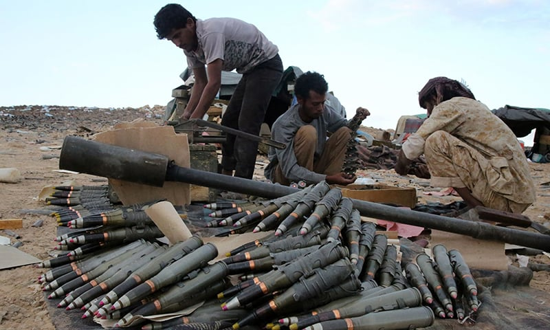 Yemeni tribesmen from the Popular Resistance Committees prepare and review ammunition. ─ AFP