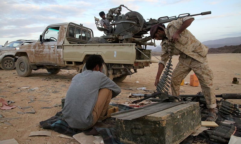 Yemeni tribesmen from the Popular Resistance Committees prepare ammunition. ─ AFP