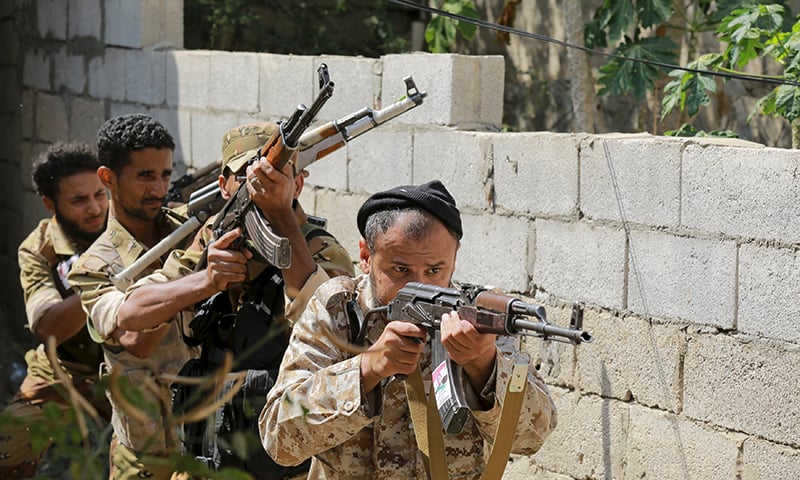 Soldiers loyal to Yemen's government aim their rifles during a training exercise. ─ Reuters